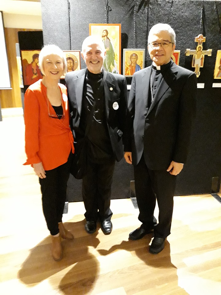 Icon exhibition Images of the Divine in Canberra. Sue Orchison (in red) who organised things, Richard Charlwood and Apostolic Nuncio, Most Reverend Adolfo Tito Yllana.